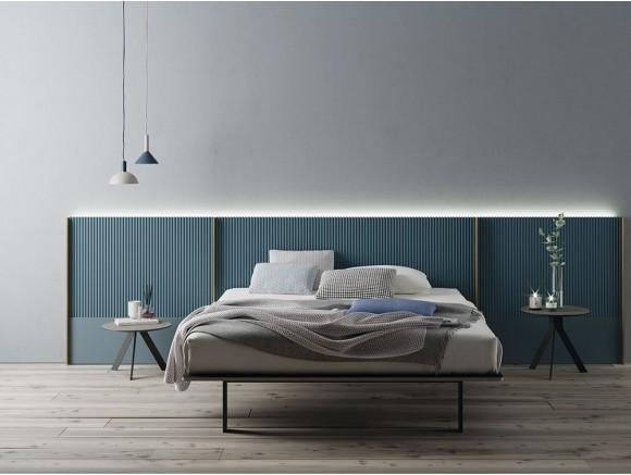 Dormitorio moderno con cabecero modelo New Kandor tapizado en azul índigo