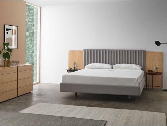 Dormitorio con cabecero tapizado en acabado roble Land