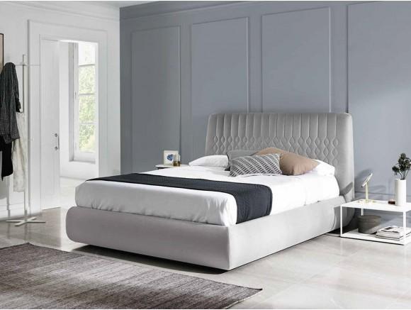 Dormitorio con cabecero tapizado Geo con mesitas de noche Daem y Cava